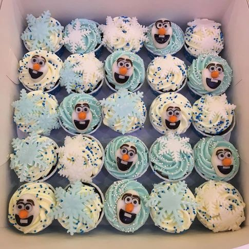Olaf from the movie Frozen cupcakes with snowflake toppers